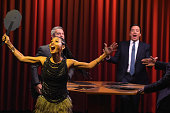 Jimmy Fallon Jada Pinkett Smith and Andy Cohen play a game of 'Famous Face Off' during a taping of 'The Tonight Show Starring Jimmy Fallon' at...