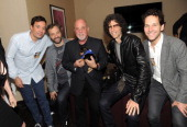 Jimmy Fallon Judd Apatow Billy Joel Howard Stern and Paul Rudd backstage at Madison Square Garden on May 9 2014 in New York City