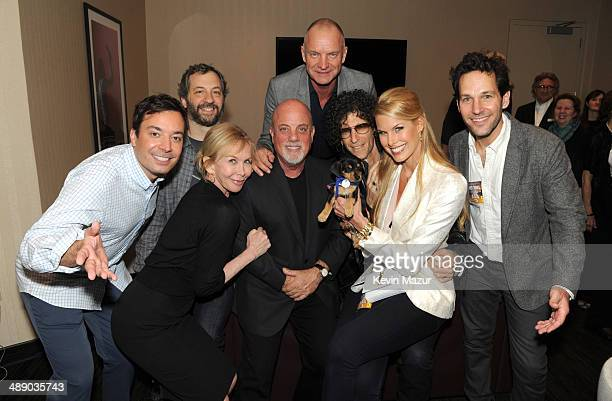 Jimmy Fallon Judd Apatow Trudie Styler Billy Joel Sting Howard Stern Beth Stern and Paul Rudd backstage at Madison Square Garden on May 9 2014 in New...