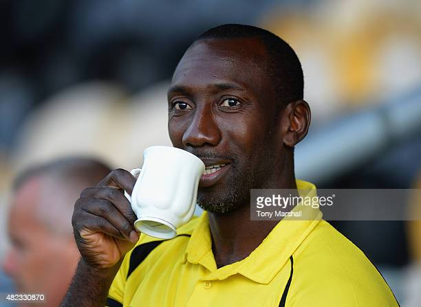 Jimmy Floyd Hasselbaink Manager of Burton Albion enjoys a cup of tea before the Pre Season Friendly match between Burton Albion and Leicester City at...