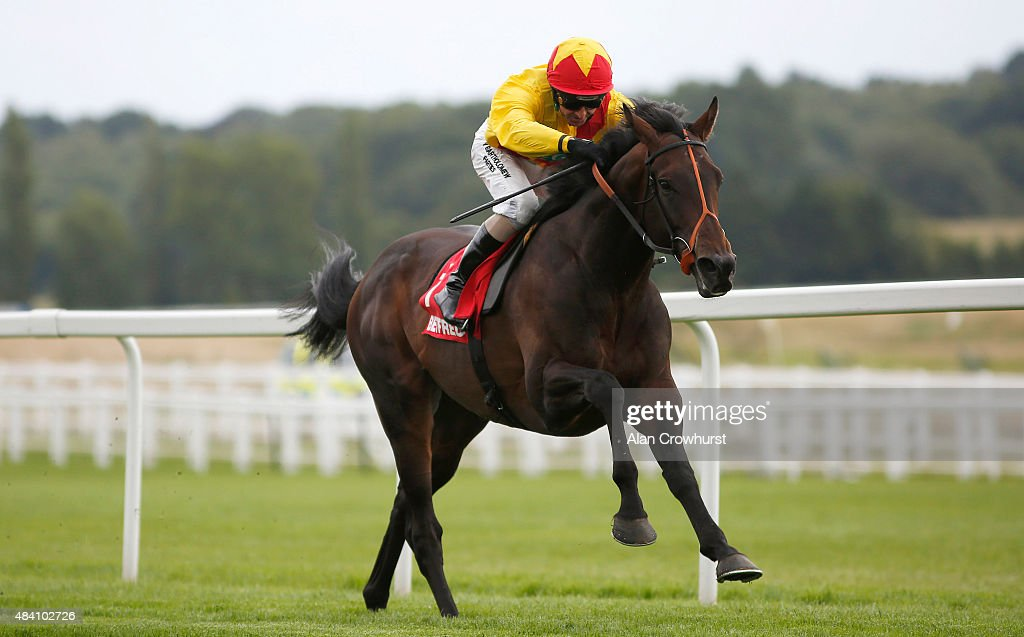 Jimmy Fortune riding Agent Murphy win The Betfred Geoffrey Freer Stakes at Newbury racecourse on August 15, 2015 in Newbury, England.