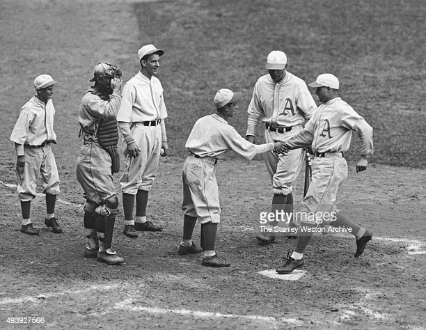 Jimmy Foxx of the Philadelphia Athletics is congratulated after hitting a home run during Game 4 of the 1931 World Series against the St Louis...