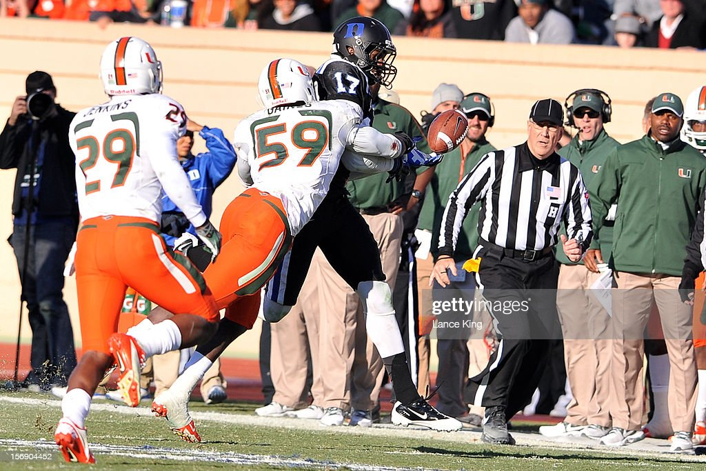 Jimmy Gaines #59 of the Miami Hurricanes breaks up a pass intended for Issac Blakeney #17 of the Duke Blue Devils at Wallace Wade Stadium on November 24, 2012 in Durham, North Carolina.