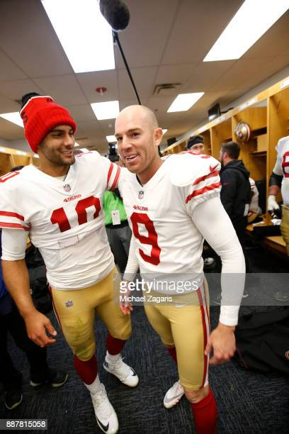 Jimmy Garoppolo and Robbie Gould of the San Francisco 49ers celebrate in the locker room following the game against the Chicago Bears at Soldier...