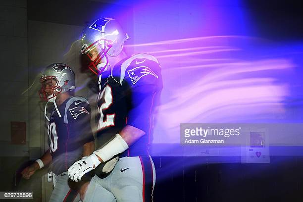 Jimmy Garoppolo and Tom Brady of the New England Patriots walk through the tunnel prior to the game against the Baltimore Ravens at Gillette Stadium...