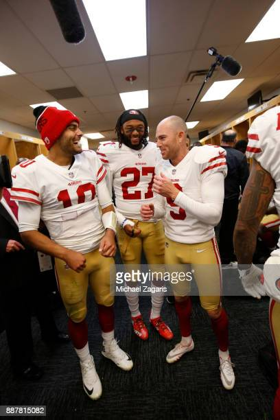 Jimmy Garoppolo Dexter McCoil and Robbie Gould of the San Francisco 49ers celebrate in the locker room following the game against the Chicago Bears...