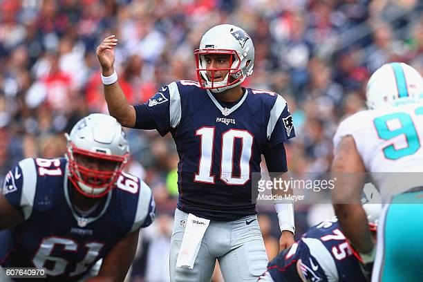 Jimmy Garoppolo of the New England Patriots communicates at the line of scrimmage during the first half against the Miami Dolphins at Gillette...
