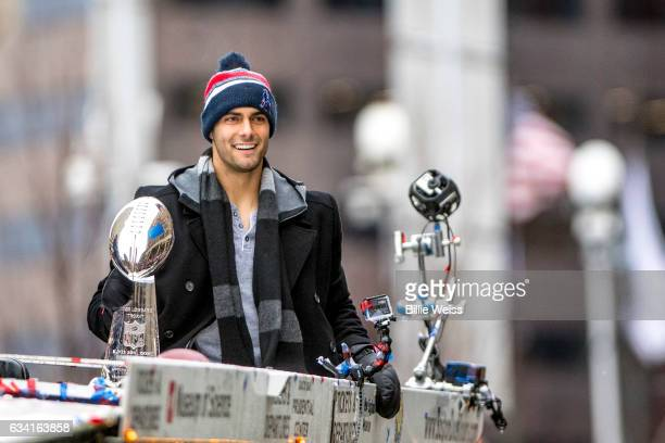 Jimmy Garoppolo of the New England Patriots holds the Vince Lombardi trophy during the Super Bowl victory parade on February 7 2017 in Boston...