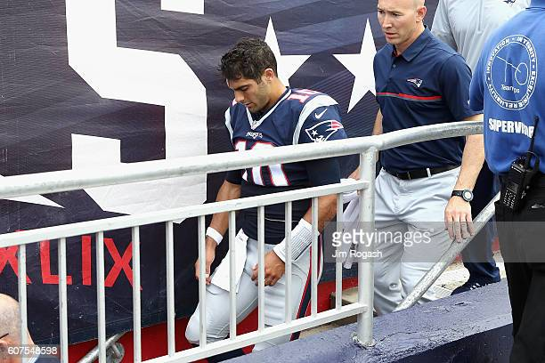 Jimmy Garoppolo of the New England Patriots leaves the field after suffering an injury during the second quarter against the Miami Dolphins at...