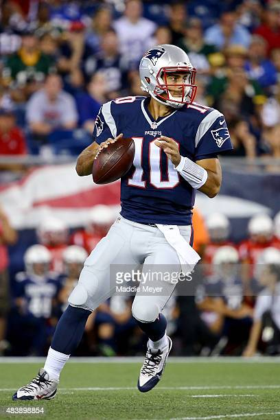 Jimmy Garoppolo of the New England Patriots looks to pass in the second quarter against the Green Bay Packers during a preseason game at Gillette...