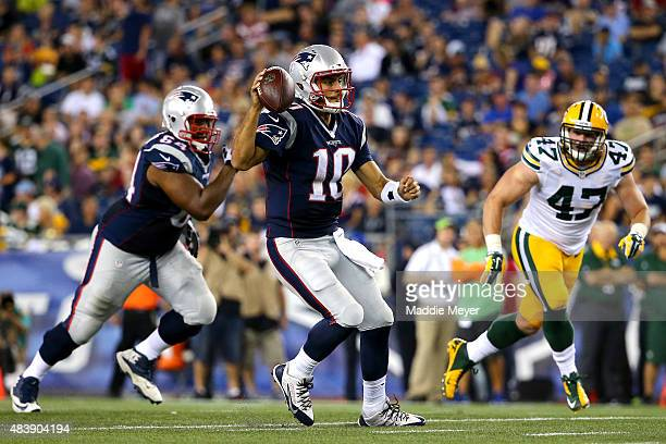 Jimmy Garoppolo of the New England Patriots looks to pass in the second half against the Green Bay Packers during a preseason game at Gillette...