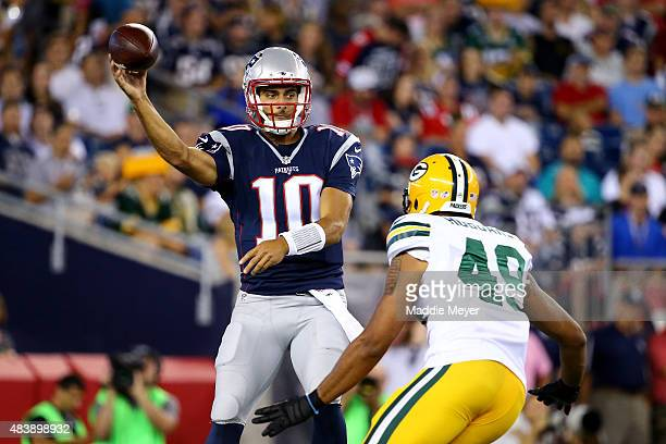 Jimmy Garoppolo of the New England Patriots passes against Casey Hayward of the Green Bay Packers in the second quarter during a preseason game at...