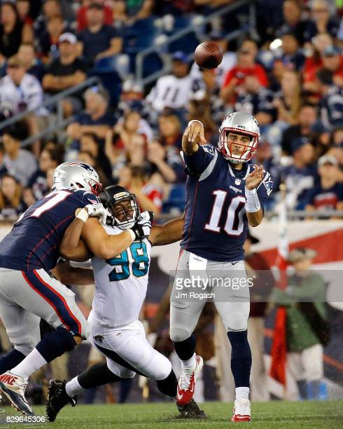 Jimmy Garoppolo of the New England Patriots prepares throw against the Jacksonville Jaguars in the second half at Gillette Stadium on August 10 2017...