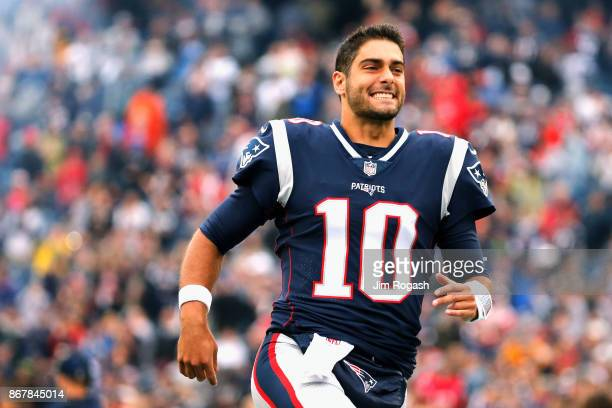 Jimmy Garoppolo of the New England Patriots reacts before a game against the Los Angeles Chargers at Gillette Stadium on October 29 2017 in Foxboro...