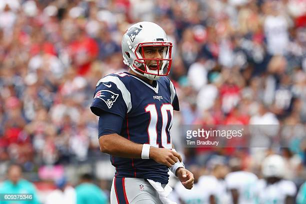 Jimmy Garoppolo of the New England Patriots reacts during the first half against the Miami Dolphins at Gillette Stadium on September 18 2016 in...
