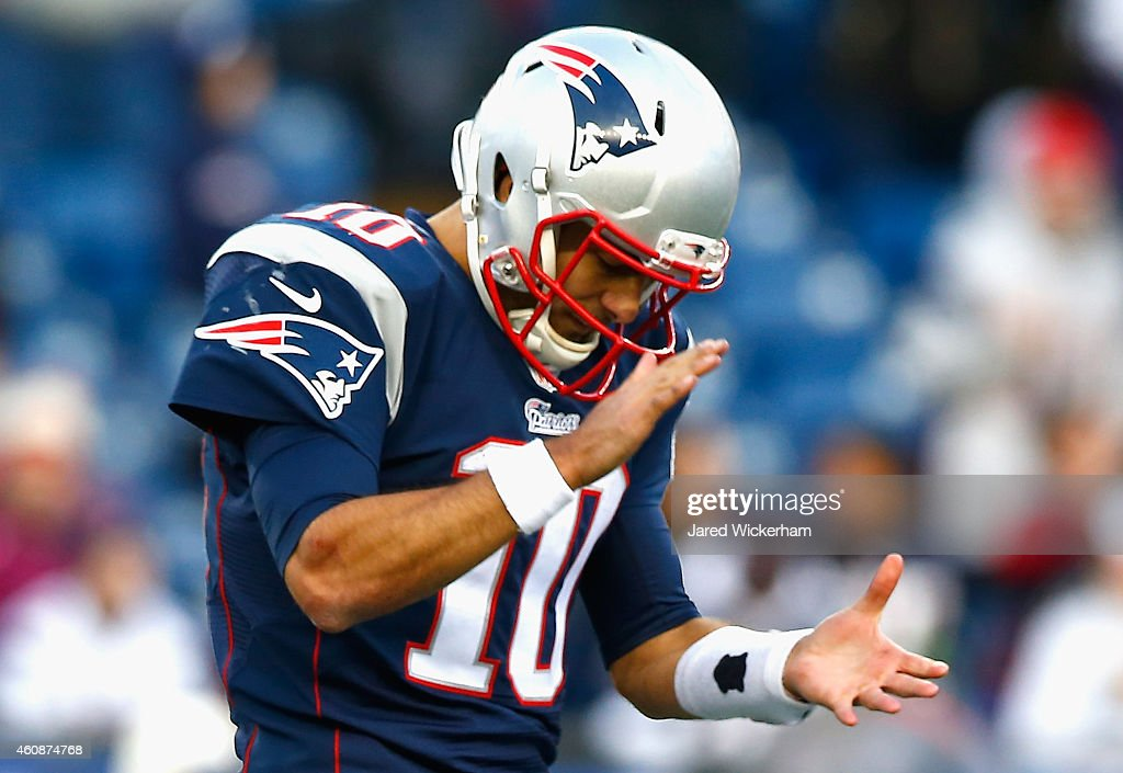 <a gi-track='captionPersonalityLinkClicked' href=/galleries/search?phrase=Jimmy+Garoppolo&family=editorial&specificpeople=12185713 ng-click='$event.stopPropagation()'>Jimmy Garoppolo</a> #10 of the New England Patriots reacts during the fourth quarter against the Buffalo Bills at Gillette Stadium on December 28, 2014 in Foxboro, Massachusetts.