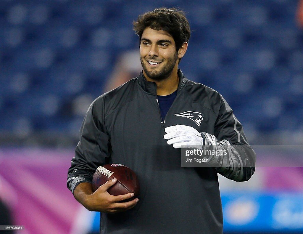 <a gi-track='captionPersonalityLinkClicked' href=/galleries/search?phrase=Jimmy+Garoppolo&family=editorial&specificpeople=12185713 ng-click='$event.stopPropagation()'>Jimmy Garoppolo</a> #10 of the New England Patriots smiles before a game against the Cincinnati Bengals at Gillette Stadium on October 5, 2014 in Foxboro, Massachusetts.