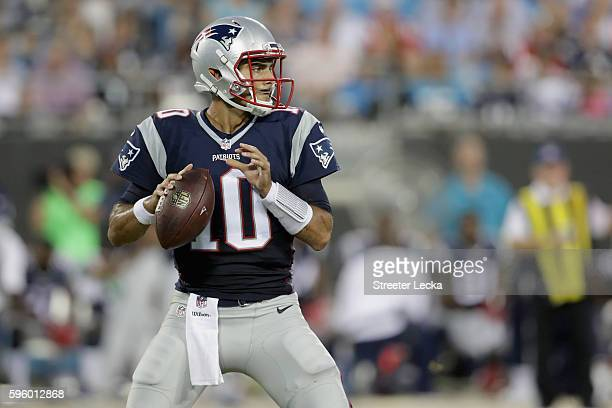 Jimmy Garoppolo of the New England Patriots throws a pass against the Carolina Panthers in the 1st quarter during their game at Bank of America...