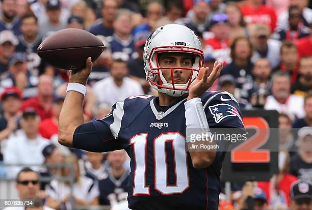 Jimmy Garoppolo of the New England Patriots throws a pass during the first half against the Miami Dolphins at Gillette Stadium on September 18 2016...