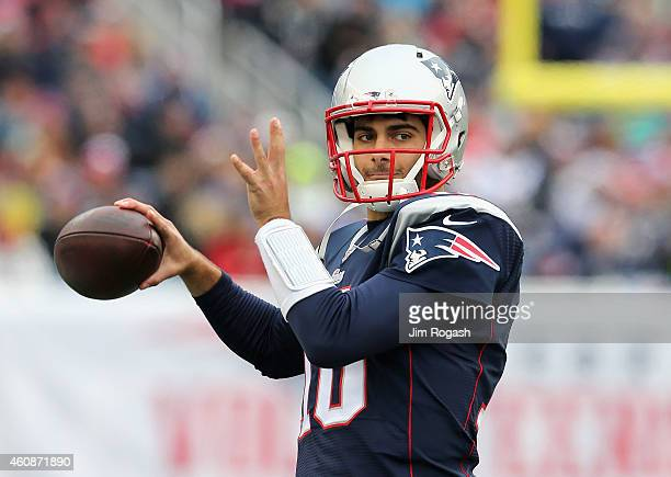 Jimmy Garoppolo of the New England Patriots warms up before a game against the Buffalo Bills at Gillette Stadium on December 28 2014 in Foxboro...
