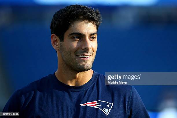 Jimmy Garoppolo of the New England Patriots warms up before a preseason game against the Green Bay Packers at Gillette Stadium on August 13 2015 in...