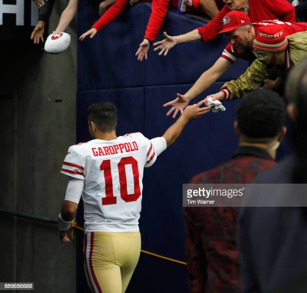 Jimmy Garoppolo of the San Francisco 49ers gives a towel to fans as he walks up the tunnel after the game against the Houston Texans at NRG Stadium...