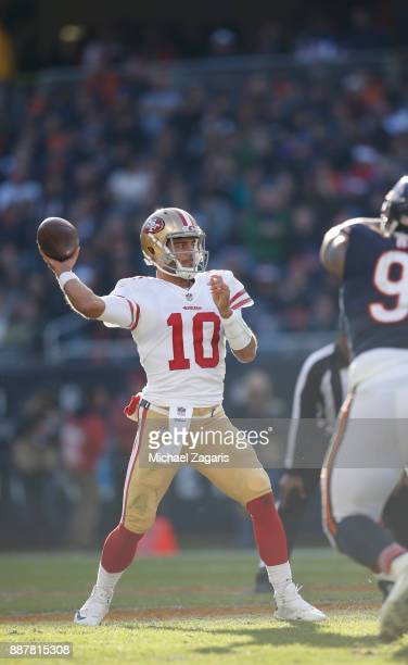 Jimmy Garoppolo of the San Francisco 49ers passes during the game against the Chicago Bears at Soldier Field on December 3 2017 in Chicago Illinois...