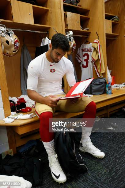 Jimmy Garoppolo of the San Francisco 49ers reviews plays in the locker room prior to the game against the Chicago Bears at Soldier Field on December...