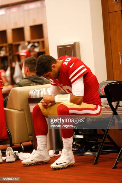 Jimmy Garoppolo of the San Francisco 49ers sits in the locker room prior to the game against the Seattle Seahawks at Levi's Stadium on November 26...