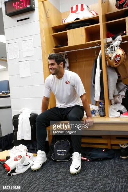 Jimmy Garoppolo of the San Francisco 49ers sits in the locker room prior to the game against the Chicago Bears at Soldier Field on December 3 2017 in...
