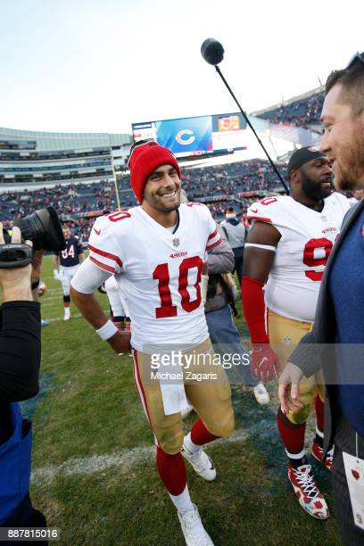 Jimmy Garoppolo of the San Francisco 49ers stands on the field following the game against the Chicago Bears at Soldier Field on December 3 2017 in...