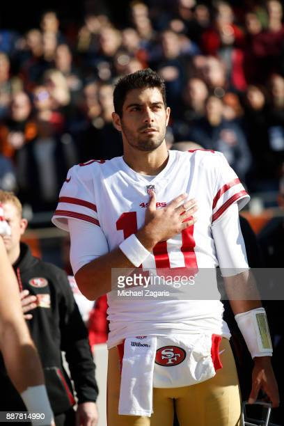 Jimmy Garoppolo of the San Francisco 49ers stands on the sideline for the anthem prior to the game against the Chicago Bears at Soldier Field on...