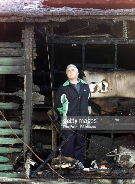 Jimmy Gaston a parent surveys the damage to the Irish language primary school in Ulster which was extensively damaged in what was believed to be a...
