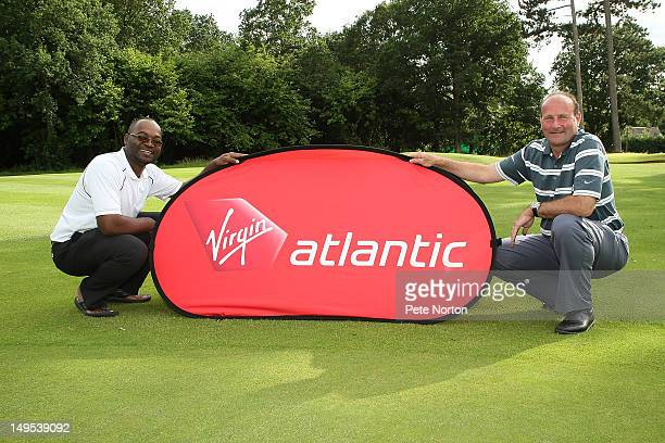 Jimmy Gavore and club professional Nigel Whitton of Farnham Park Golf Club pose after winning the Virgin Atlantic PGA National ProAm Championship...