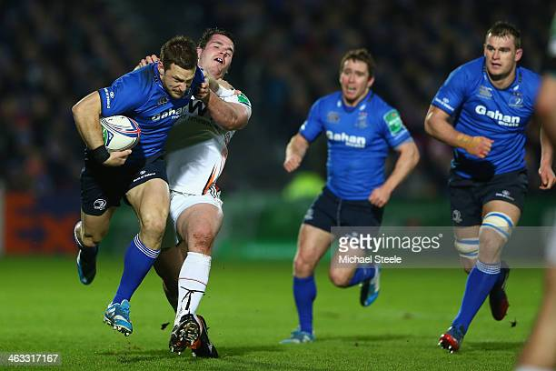 Jimmy Gopperth of Leinster is held up by Ryan Bevington of Ospreys during the Heineken Cup Pool One match between  Leinster and Ospreys at the Royal...
