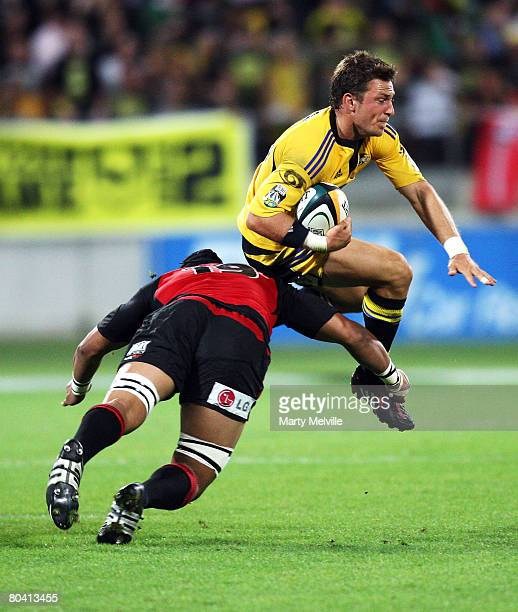 Jimmy Gopperth of the Hurricanes gets tackled by Nasi Manu of the Crusaders during the round seven Super 14 match betweeen the Hurricanes and the...