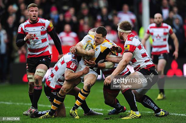 Jimmy Gopperth of Wasps is tackled by Matt Kvesic during the Aviva Premiership match between Gloucester Rugby and Wasps at Kingsholm Stadium on March...