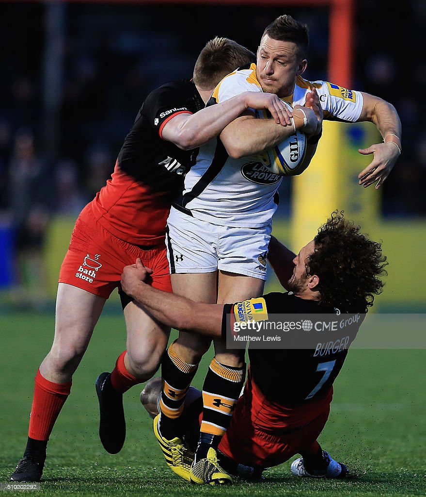<a gi-track='captionPersonalityLinkClicked' href=/galleries/search?phrase=Jimmy+Gopperth&family=editorial&specificpeople=561375 ng-click='$event.stopPropagation()'>Jimmy Gopperth</a> of Wasps is tackled by Nick Tompkins and <a gi-track='captionPersonalityLinkClicked' href=/galleries/search?phrase=Jacques+Burger&family=editorial&specificpeople=4017985 ng-click='$event.stopPropagation()'>Jacques Burger</a> of Saracens during the Aviva Premiership match between Saracens and Wasps at Allianz Park on February 14, in Barnet, England.