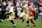 Jimmy Graham of New Orleans Saints runs away from Carlos Rogers of the San Francisco 49ers and goes 66 yards for a touchdown in the fourth quarter...