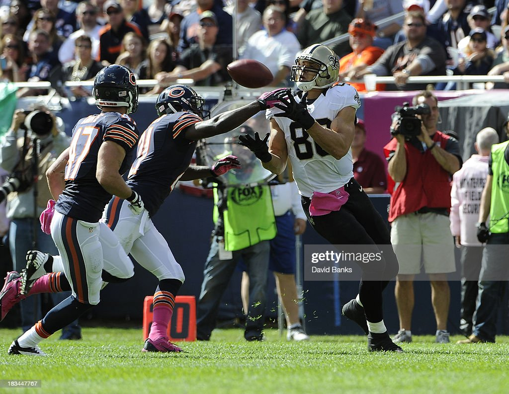 Jimmy Graham #80 of the New Orleans Saints catches a pass in front of Tim Jennings #26 of the Chicago Bears during the first half on October 6, 2013 at Soldier Field in Chicago, Illinois.