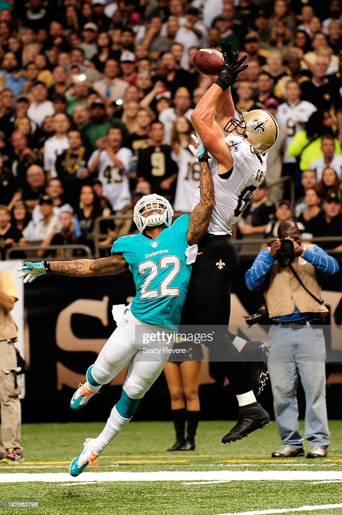 <a gi-track='captionPersonalityLinkClicked' href=/galleries/search?phrase=Jimmy+Graham&family=editorial&specificpeople=834247 ng-click='$event.stopPropagation()'>Jimmy Graham</a> #80 of the New Orleans Saints catches a touchdown pass over <a gi-track='captionPersonalityLinkClicked' href=/galleries/search?phrase=Jamar+Taylor&family=editorial&specificpeople=4483750 ng-click='$event.stopPropagation()'>Jamar Taylor</a> #22 of the Miami Dolphins during a game at the Mercedes-Benz Superdome on September 30, 2013 in New Orleans, Louisiana.