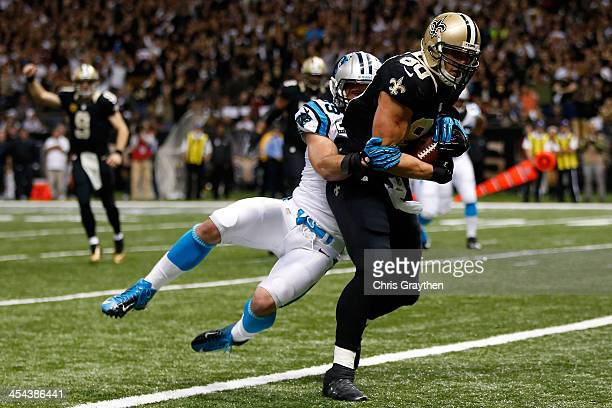 Jimmy Graham of the New Orleans Saints is tackled as he scores a touchdown by Luke Kuechly of the Carolina Panthers at MercedesBenz Superdome on...