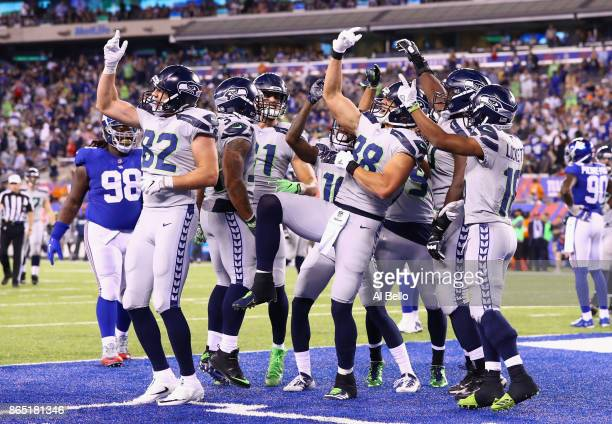 Jimmy Graham of the Seattle Seahawks celebrates his touchdown with teammates during the fourth quarter of the game against the New York Giants at...