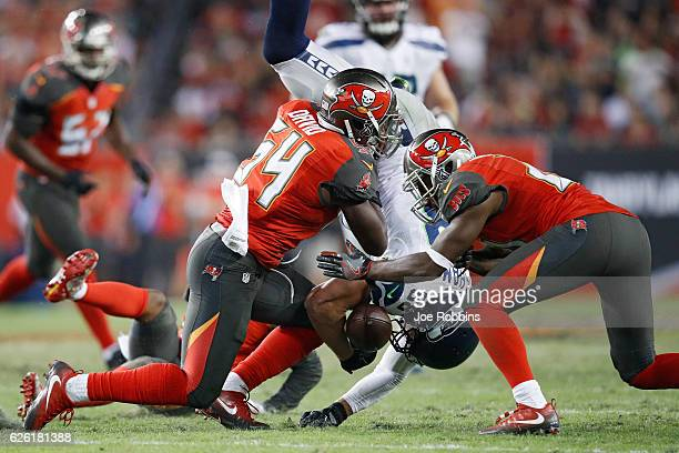 Jimmy Graham of the Seattle Seahawks fumbles the ball after being hit by Lavonte David of the Tampa Bay Buccaneers in the fourth quarter of the game...