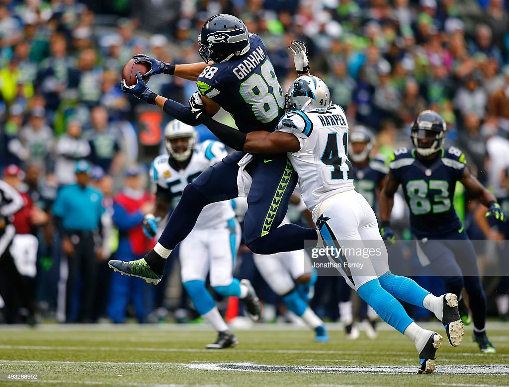 Jimmy Graham of the Seattle Seahawks makes a catch against Roman Harper of the Carolina Panthers at CenturyLink Field on October 18 2015 in Seattle...