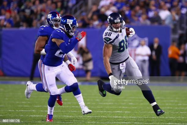 Jimmy Graham of the Seattle Seahawks runs the ball before being tackled by Darian Thompson of the New York Giants during the third quarter of the...