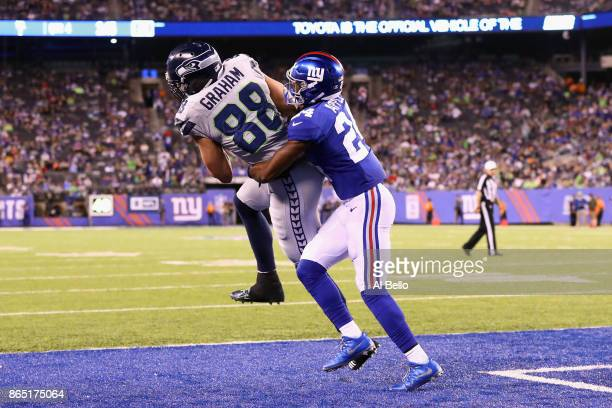 Jimmy Graham of the Seattle Seahawks scores a touchdown against Eli Apple of the New York Giants during the fourth quarter of the game at MetLife...