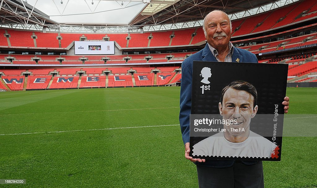 <a gi-track='captionPersonalityLinkClicked' href=/galleries/search?phrase=Jimmy+Greaves&family=editorial&specificpeople=209221 ng-click='$event.stopPropagation()'>Jimmy Greaves</a> poses with his stamp during the Royal Mail Stamp Launch at Wembley Stadium on May 8, 2013 in London, England.