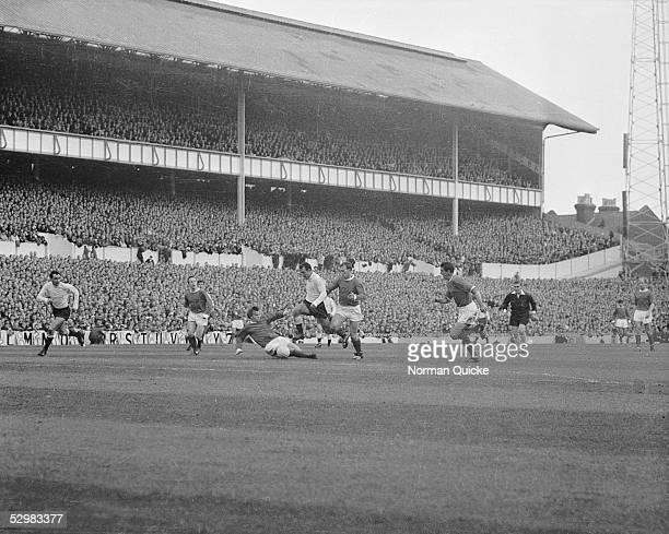 Jimmy Greaves scores for Spurs during a match between Tottenham Hotspur and Manchester United 18th October 1965