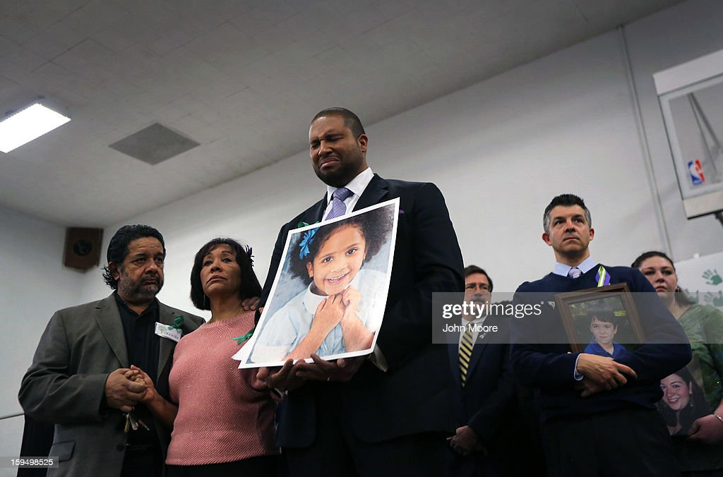 Jimmy Green holds a photo of his daughter Anna Grace Marquez Green during a press conference with fellow parents on the one month anniversary of the Newtown elementary school massacre on January 14, 2013 in Newtown, Connecticut. Eleven families of Sandy Hook massacre victims came to the event one month after the shooting to give their support to Sandy Hook Promise, a new non-profit with the goal of preventing such tragedies in the future.